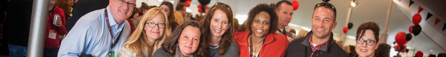 A group f alumni celebrate together at the Fifth Quarter during Homecoming & Reunion Weekend.